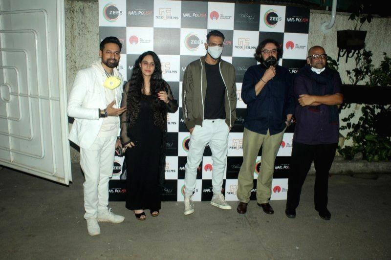 Actor Arjun Rampal with the star cast of upcoming ZEE5 original film 'Nail Polish' during its special screening, in Mumbai on Jan 6, 2021. - Arjun Rampal