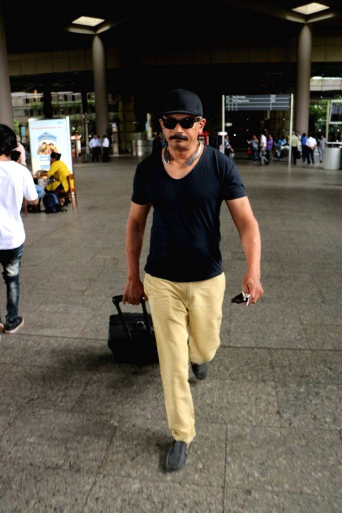 Actor Atul Kulkarni at Chhatrapati Shivaji Maharaj International Airport in Mumbai on July 5, 2017. - Atul Kulkarni