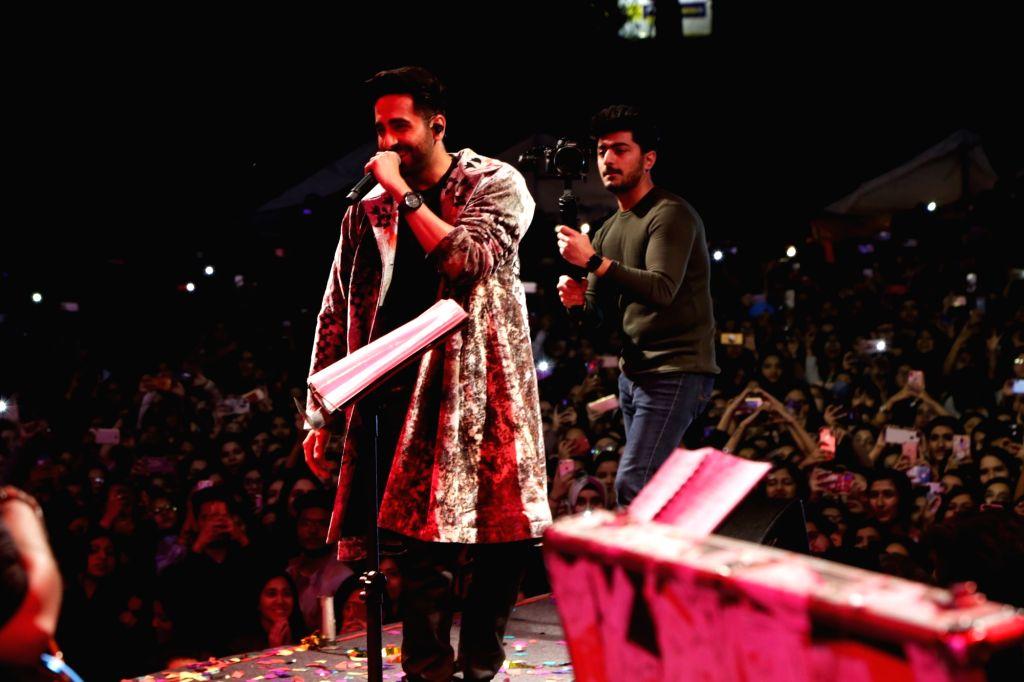 Actor Ayushmann Khurana performing live at Lady Irwin College in New Delhi on Feb. 9, 2019. - Ayushmann Khurana