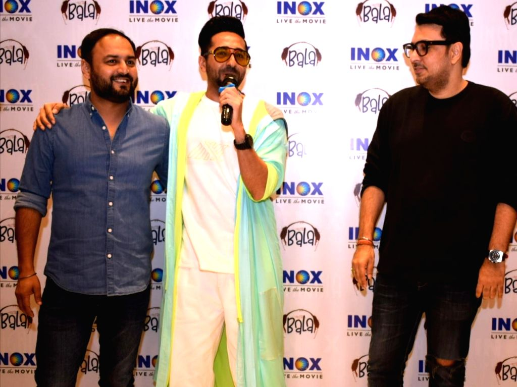 "Actor Ayushmann Khurrana accompanied by Director Amar Kaushik and producer Dinesh Vijan, addresses during the promotions of the film ""Bala"" in New Delhi on Nov 8, 2019. - Ayushmann Khurrana"