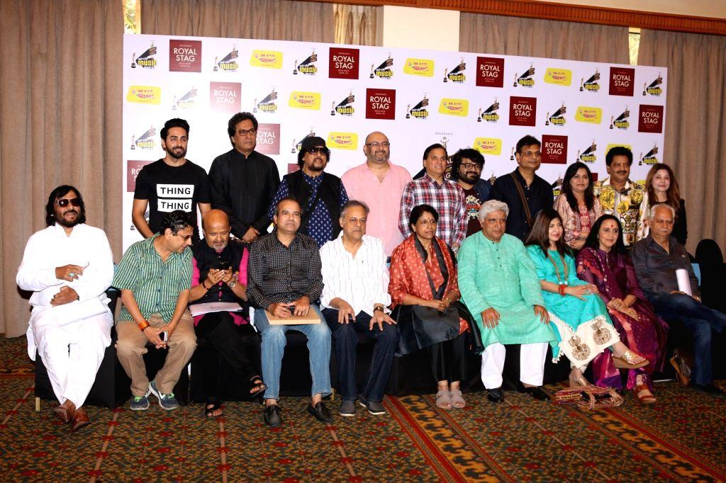 Actor Ayushmann Khurrana and script writer Javed Akhtar during Radio Mirchi Music Awards in Mumbai on Jan 24, 2016. - Ayushmann Khurrana