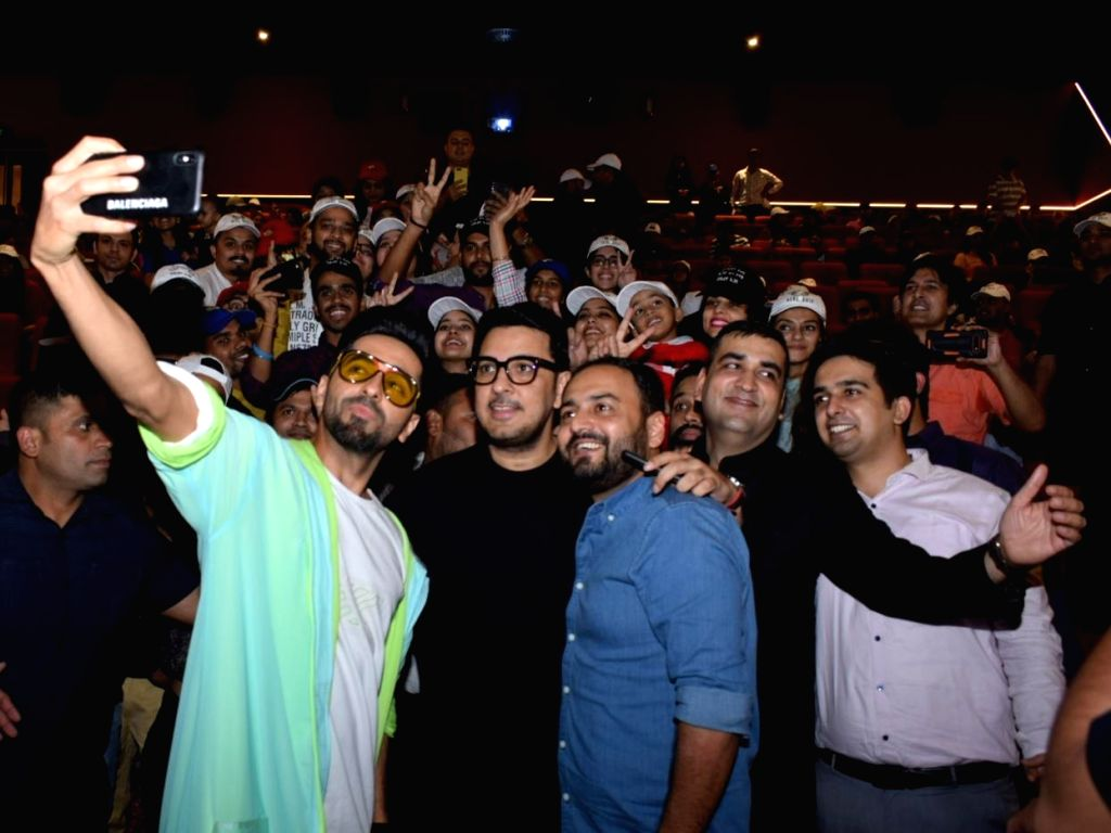 "Actor Ayushmann Khurrana, director Amar Kaushik and producer Dinesh Vijan pose for selfies with fans during the promotions of the film ""Bala"" in New Delhi on Nov 8, 2019. - Ayushmann Khurrana"