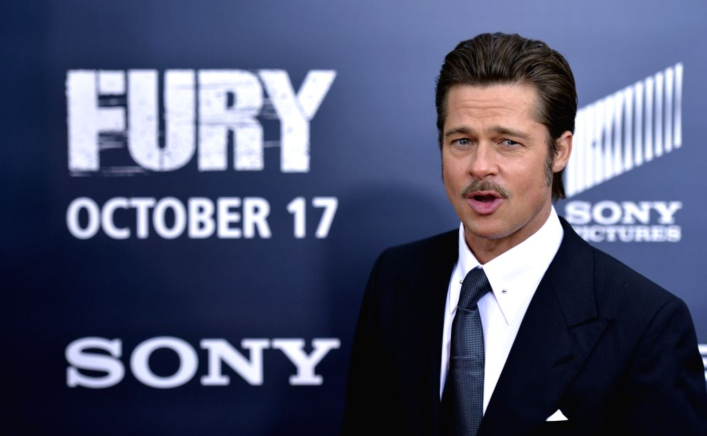 Actor Brad Pitt. (File Photo: Xinhua/Yin Bogu/IANS) - Brad Pitt
