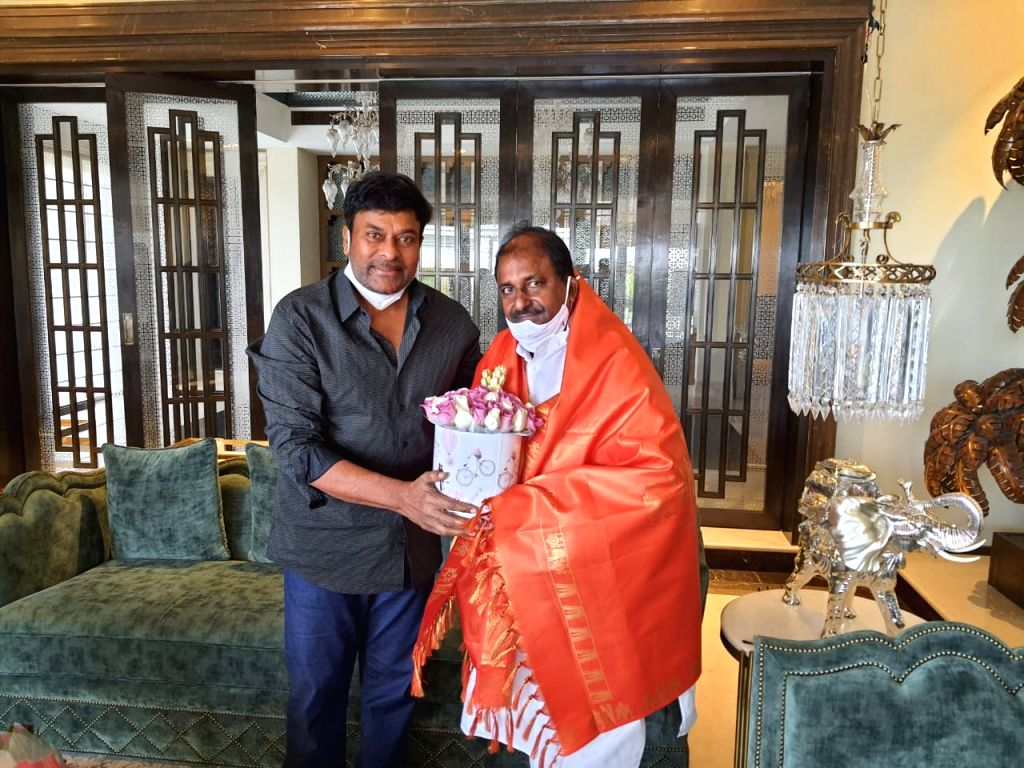 Actor Chiranjeevi meets newly appointed Andhra Pradesh BJP President Somu Weeraraj to greet him on the occasion, in Hyderabad on Aug 6, 2020. - Chiranjeevi