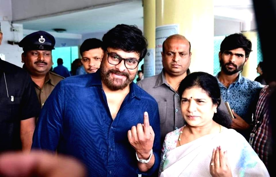 Actor Chiranjeevi shows his inked finger after casting his vote for Telangana Assembly elections in Hyderabad on Dec 7, 2018. - Chiranjeevi