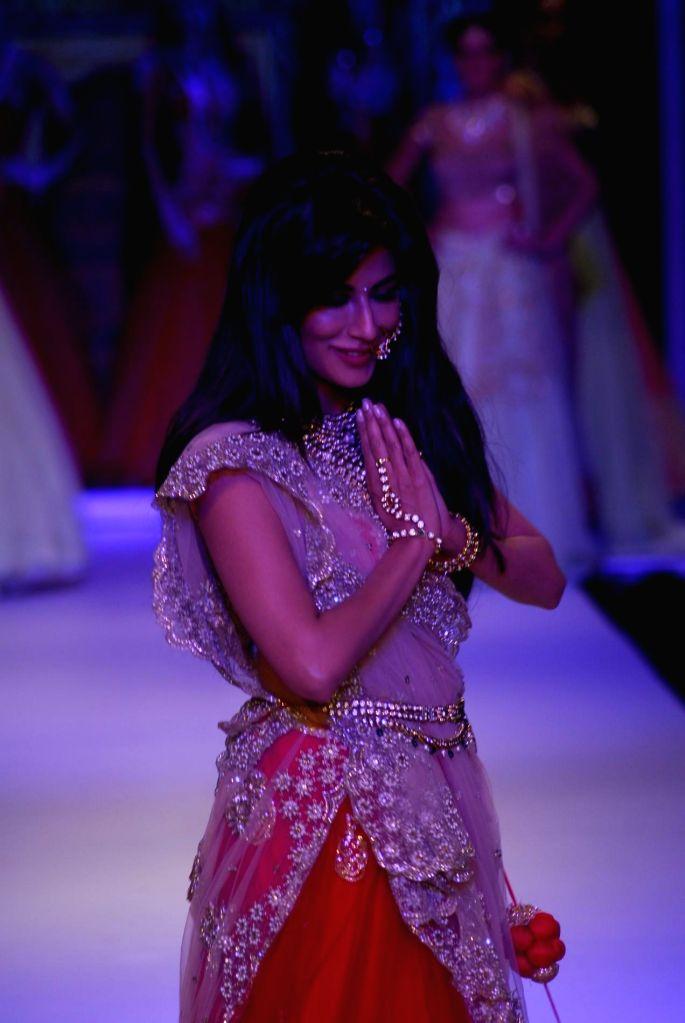 Actor Chitrangada Singh display jewellery by Moni Agarwal during the India International Jewellery Week (IIJW) in Mumbai, on July 14, 2014. - Chitrangada Singh
