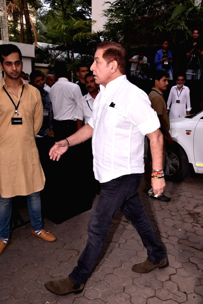 Actor Dalip Tahil arrives to attend Late actor Shashi Kapoor's condolence meeting in Mumbai on Dec 7, 2017. - Dalip Tahil and Shashi Kapoor