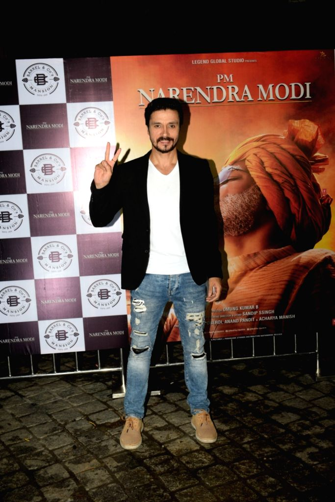 "Actor Darshan Kumar at the success party of his recently released film ""PM Narendra Modi"", in Mumbai, on June 13, 2019. - Darshan Kumar and Narendra Modi"
