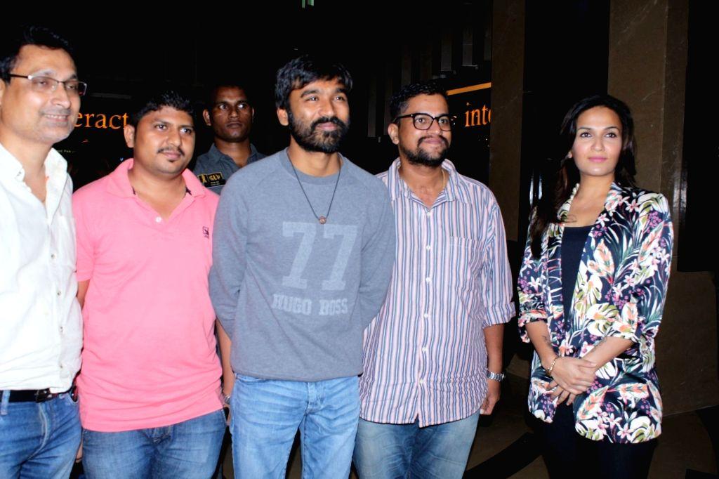 "Actor Dhanush along with ""VIP 2"" director Soundarya Rajinikanth at the special screening of their upcoming film ""VIP 2"" in Mumbai on Aug 17, 2017. - Dhanush"