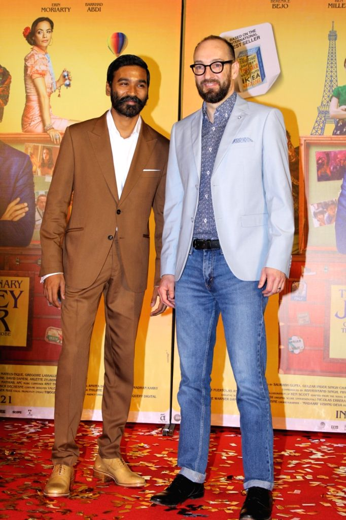 """Actor Dhanush and director Ken Scott at the trailer launch of their upcoming film """"The Extraordinary Journey of the Fakir"""", in Mumbai, on June 4, 2019. - Dhanush"""