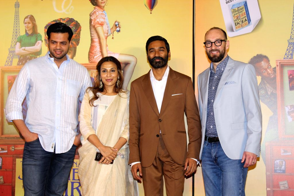 """Actor Dhanush with his wife Aishwarya R. Dhanush and director Ken Scott at the trailer launch of their upcoming film """"The Extraordinary Journey of the Fakir"""", in Mumbai, on June 4, ... - Dhanush"""