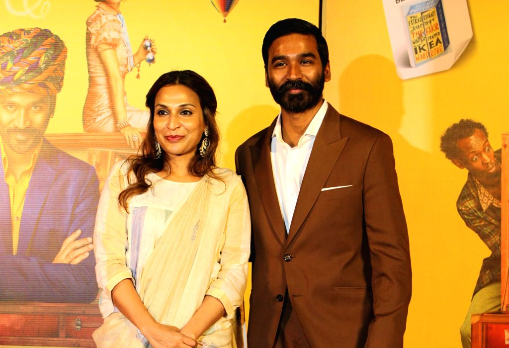 """Actor Dhanush with his wife Aishwarya R. Dhanush at the trailer launch of his upcoming film """"The Extraordinary Journey of the Fakir"""", in Mumbai, on June 4, 2019. - Dhanush"""