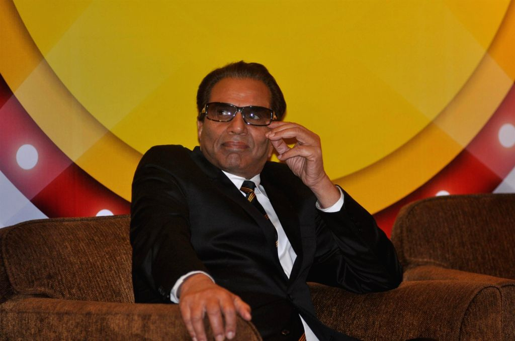 Actor Dharmendra receives Lifetime Achievement Award by OKAYA Power Group, in Mumbai, on December 19, 2013.