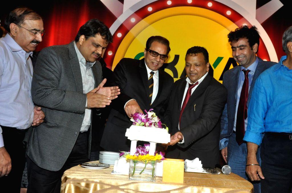 Actor Dharmendra receives Lifetime Achievement Award from Rajesh Gupta and Manoj Jain, Director OKAYA Power Group, in Mumbai, on December 19, 2013. - Rajesh Gupta and Manoj Jain
