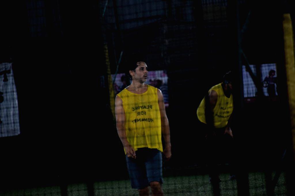 Actor Dino Morea during football match in Mumbai's Juhu on April 15, 2018 . - Dino Morea