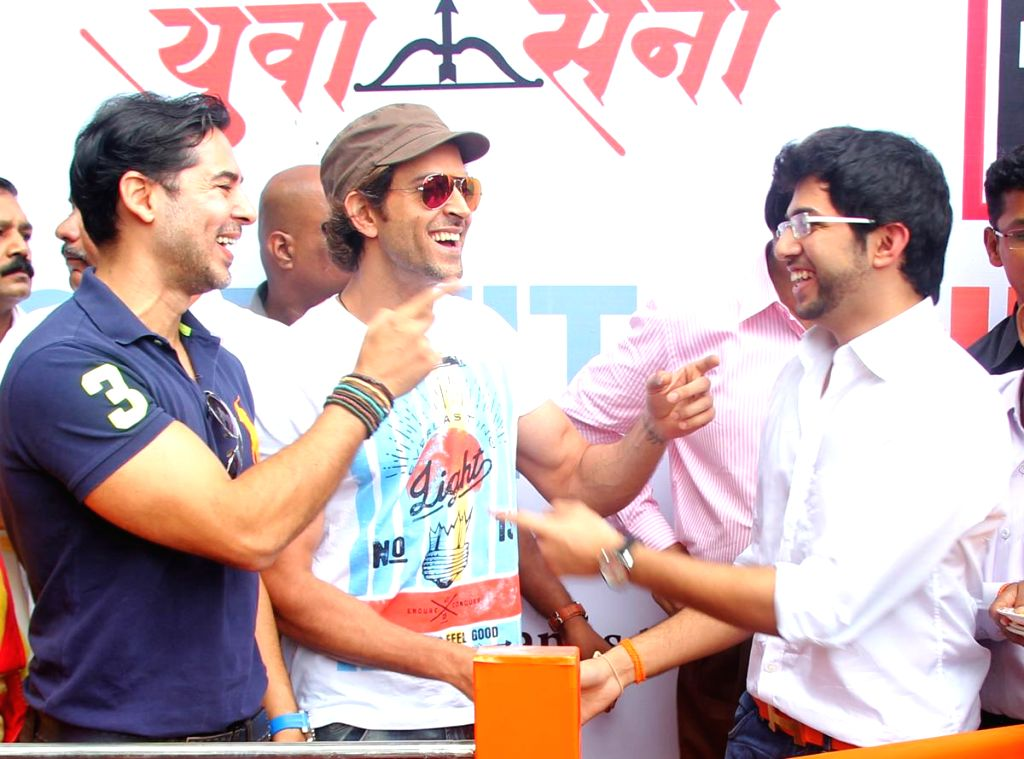 Actor Dino Morea, Yuva Sena chief Aditya Thackeray and actor Hrithik Roshan at the launch of a branch of DM Fitness at Five Gardens, Matunga in Mumbai on Sept 8, 2014. - Dino Morea and Hrithik Roshan