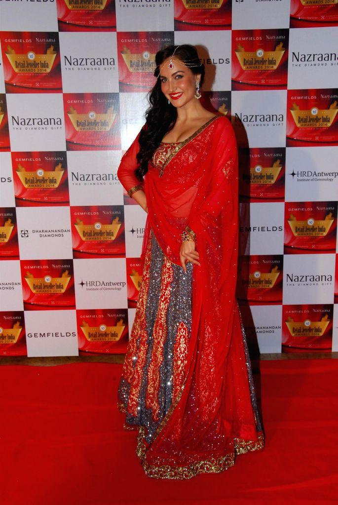 Actor Elli Avram during the 10th Annual Gemfields and Nazraana Retail Jeweller India Awards 2014 in Mumbai on July 19, 2014. (Photo : IANS) - Elli Avram