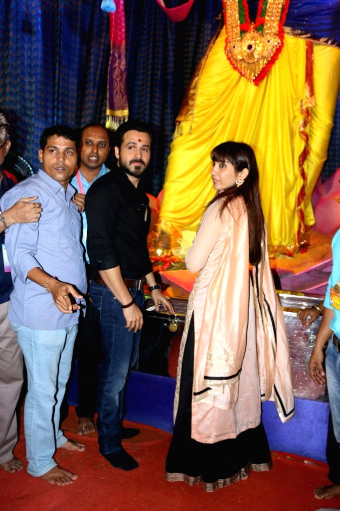 Actor Emraan Hashmi along with his wife Parveen Shahani visit Ganesh Galli Ka Raja to offer prayer on the occasion of Ganesh festival in Mumbai on Sept. 11, 2016. - Emraan Hashmi