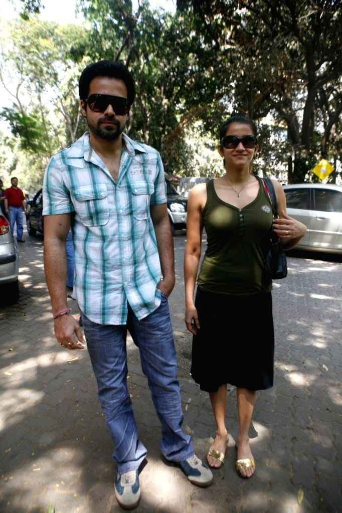Actor Emraan Hashmi and Smiley Suri arrive to cast their vote in Mumbai.