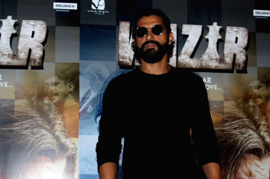 Actor Farhan Akhtar arrives to watch the first song Tere Bin from film Wazir in Mumbai on Dec 4, 2015. - Farhan Akhtar