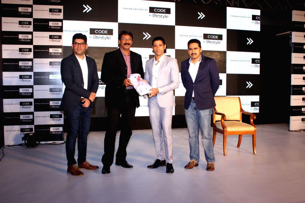 Actor Farhan Akhtar during the event in Mumbai on March 30, 2016. Lifestyle International Pvt Ltd announced Farhan Akhtar as the brand ambassador for its contemporary menswear brand - Code by ... - Farhan Akhtar
