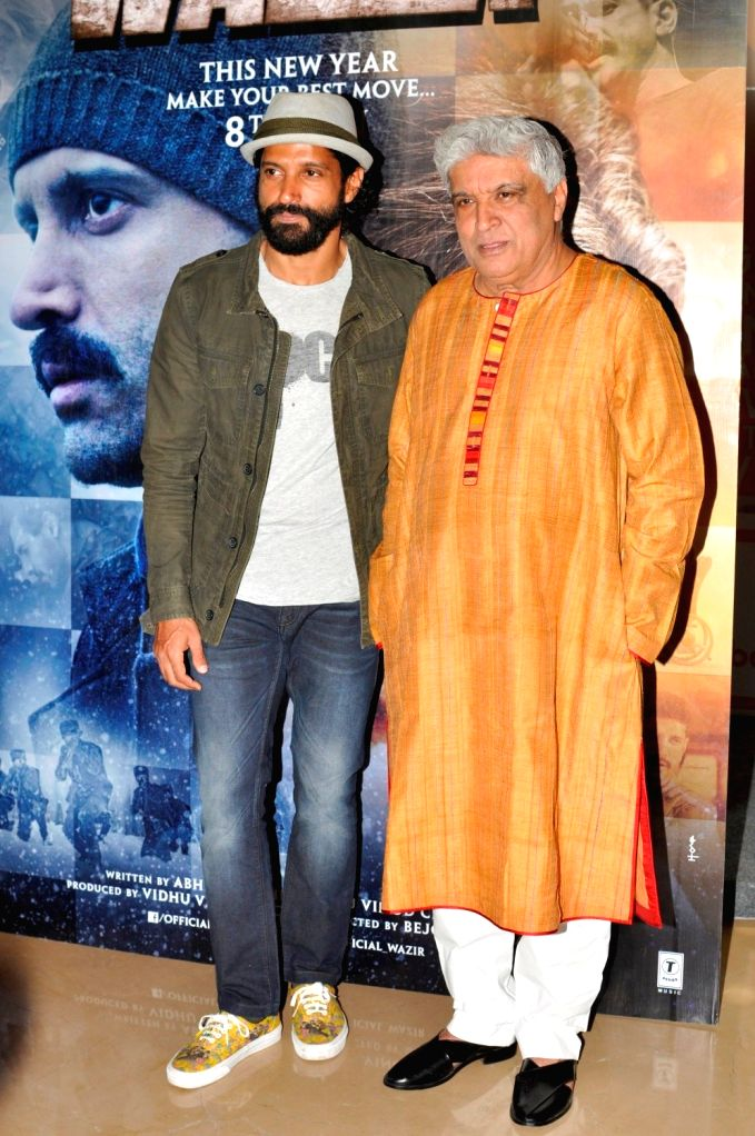Actor Farhan Akhtar with his father and lyricist Javed Akhtar during the trailer launch of film Wazir in Mumbai on Nov 18, 2015. - Farhan Akhtar