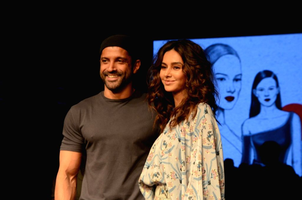 Actor Farhan Akhtar with Shibani Dandekar. (Photo: IANS) - Farhan Akhtar