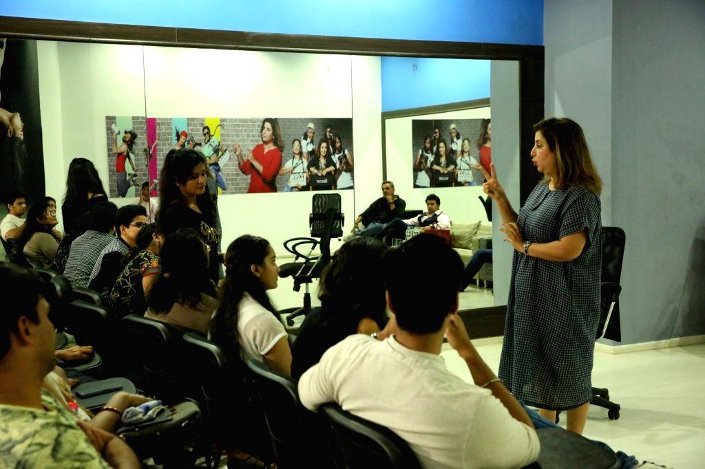 Actor, filmmaker amd choreographer Farah Khan and her team of choreographers interact with students, in Mumbai, on Oct 19, 2016. - Farah Khan