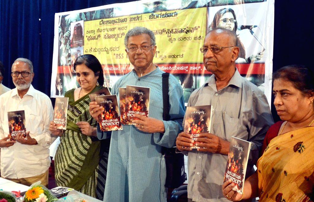 "Actor Girish Karnad with Indian civil rights activist Teesta Setalvad at the launch of book  ""RSS Antaranga"" in Bengaluru on May 15, 2017. - Girish Karnad"