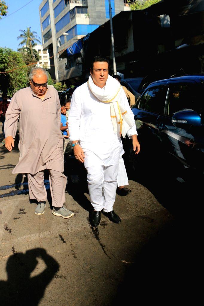 Actor Govinda arrives to attend the funeral of acting guru Roshan Taneja in Mumbai on May 11, 2019. - Govinda