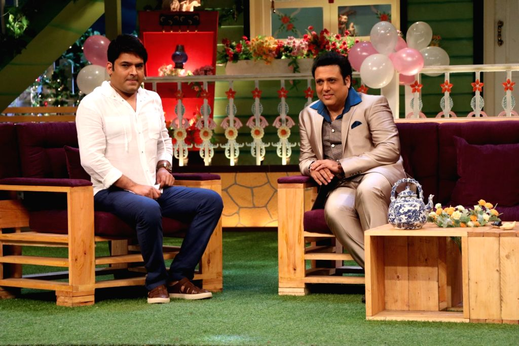 Actor Govinda with actor and stand-up comedian Kapil Sharma on the sets of The Kapil Sharma show, in Mumbai on June 22, 2016. - Govinda and The Kapil Sharma