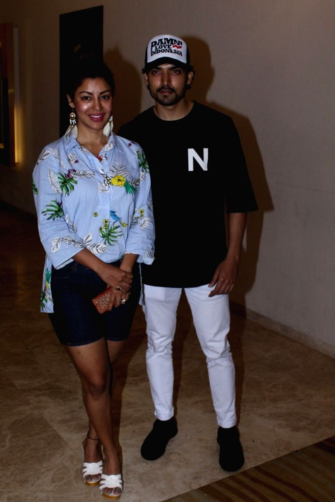 "Actor Gurmeet Choudhary along with his wife Debina Bonnerjee during the special screening of his film ""Shab"" in Mumbai, on July 1, 2017. - Gurmeet Choudhary and Debina Bonnerjee"