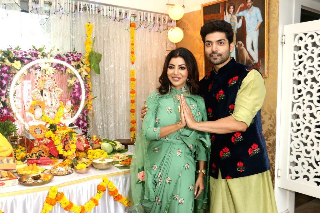 Actor Gurmeet Choudhury and his wife Debina Bonnerjee during Ganesh Chaturthi celebrations at their residence in Mumbai on Sep 2, 2019. - Gurmeet Choudhury and Debina Bonnerjee