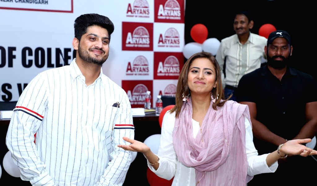 "Actor Gurnam Bhullar and Sargun Mehta during the promotions of his upcoming film ""Surkhi Bindi"" in Amritsar, on Aug 28, 2019. - Gurnam Bhullar and Sargun Mehta"