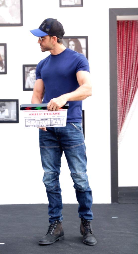 "Actor Hrithik Roshan at the muhurat of fashion designer-director Vikram Phadnis's Marathi film ""Smile Please"" in Mumbai on March 1, 2019. - Hrithik Roshan"