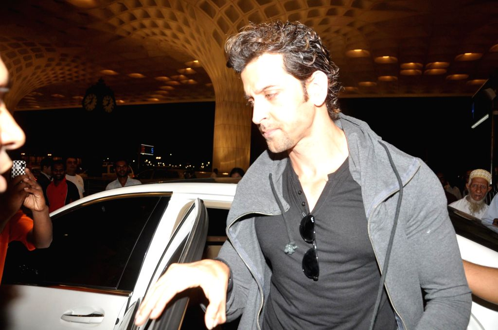 Actor Hrithik Roshan at the Terminal 2 of the Chhatrapati Shivaji International Airport, in Mumbai, on April 23, 2014. The Bollywood actor left to attend the International Indian Film Academy (IIFA) . - Hrithik Roshan