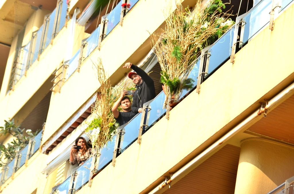 Actor Hrithik Roshan comes out in the balcony of his Juhu residence to greet his fans who had gathered to wish him on his birthday, in Mumbai on Jan 10, 2020. - Hrithik Roshan