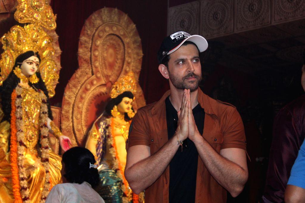 Actor Hrithik Roshan during Durga Navami celebrations at a Juhu Durga Puja pandal in Mumbai on Oct 7, 2019. - Hrithik Roshan