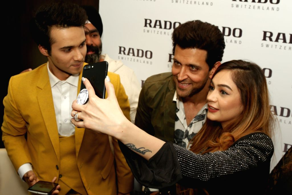 Actor Hrithik Roshan poses for selfies during the launch of a watch store in New Delhi on Feb 14, 2018. - Hrithik Roshan