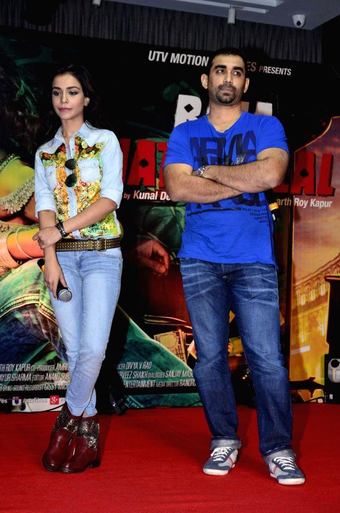 Actor Humaima Malik and filmmaker Kunal Deshmukh during the launch of film Raja Natwarlal special dance track Flip Your Collar Back in Mumbai on August 13, 2014. - Humaima Malik and Kunal Deshmukh