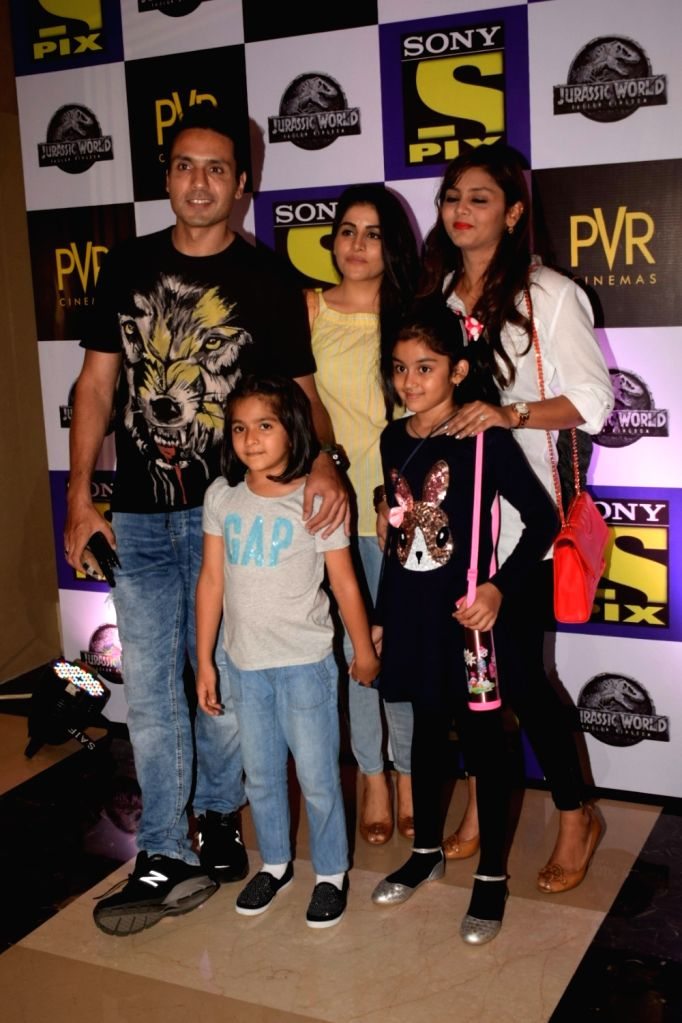 """Actor Iqbal Khan with along his wife Sneha Chhabra and son Ammaara Khan at the special screening of film """"Jurassic World: Fallen Kingdom"""" in Mumbai on June 6, 2018. - Iqbal Khan and Ammaara Khan"""