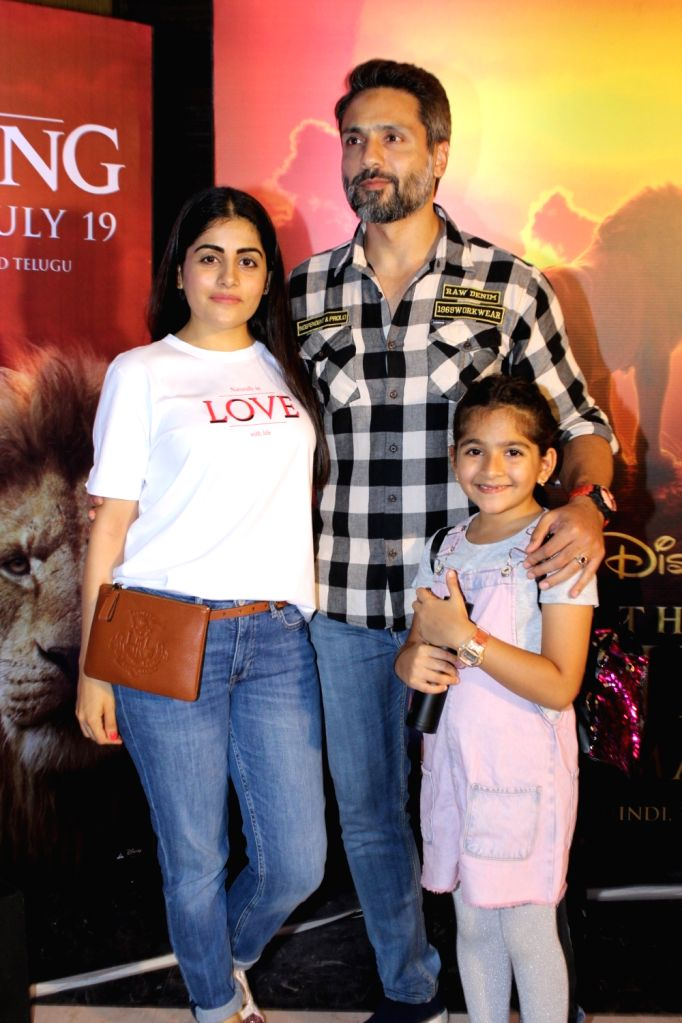 """Actor Iqbal Khan with his wife Sneha Chhabra and daughter Ammaara Khan at the special screening of upcoming animated film """"The Lion King"""" in Mumbai, on July 16, 2019. - Iqbal Khan and Ammaara Khan"""