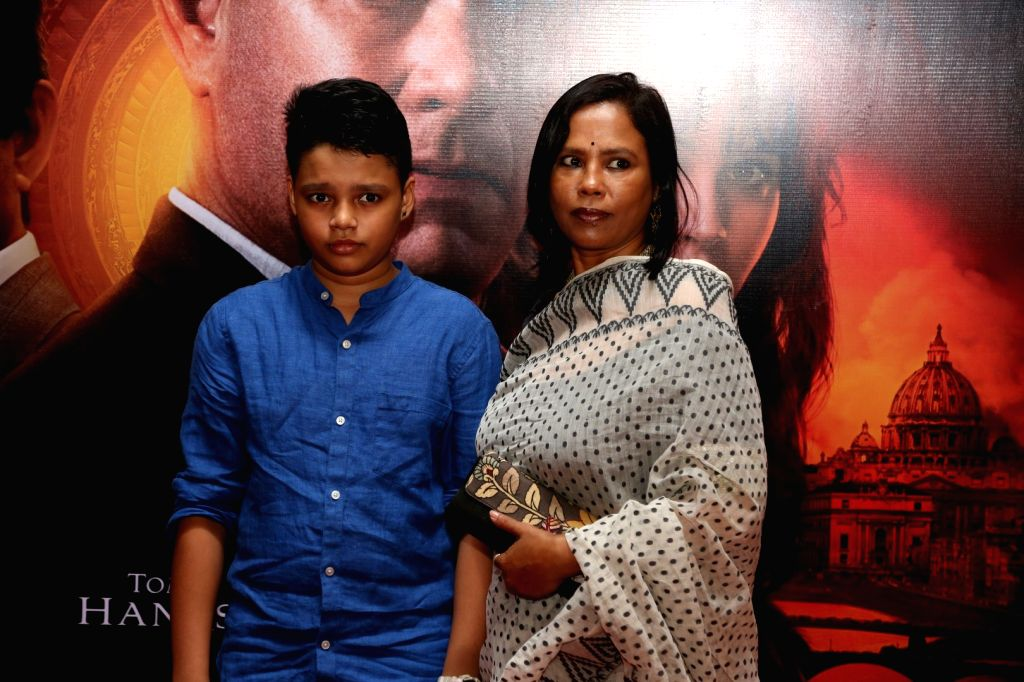 Actor Irfan Khan's wife Sutapa Sikdar and son Ayaan during the screening of film Inferno in Mumbai on Oct 12, 2016. - Irfan Khan