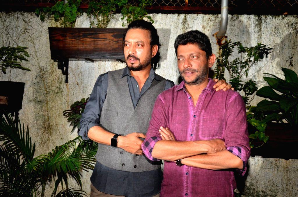 Actor Irrfan Khan and filmmaker Nishikant Kamat during the special screening of the film Madaari, in Mumbai on July 19, 2016. - Irrfan Khan