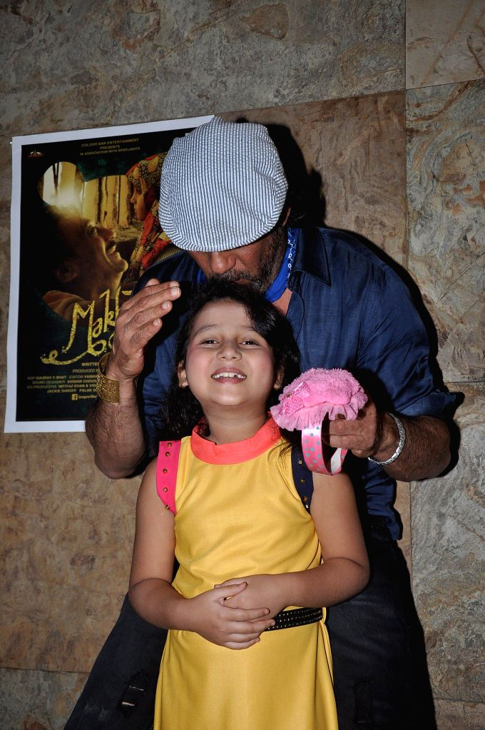 Actor Jackie Shroff and Child actor Palak Dey during the screening of Short film Makhmal in Mumbai on July 11, 2014. - Jackie Shroff