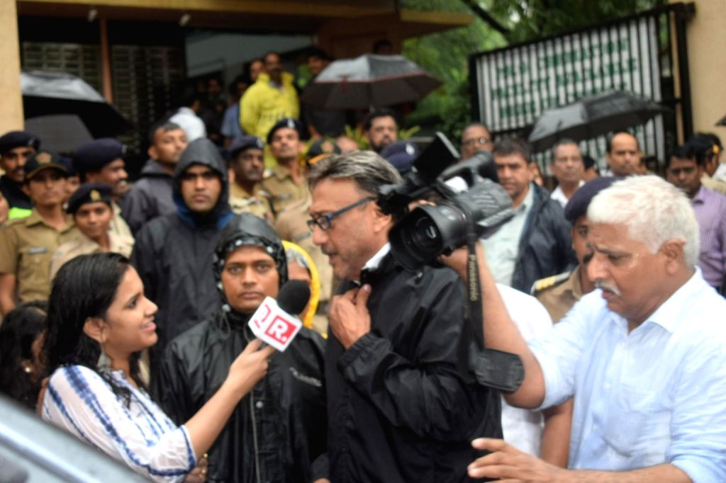 Actor Jackie Shroff talks to press as he attends the funeral of late actor-filmmaker Shashi Kapoor in Mumbai on Dec 5, 2017. The romantic screen icon of the 1970s and early 1980s died aged ... - Jackie Shroff and Shashi Kapoor