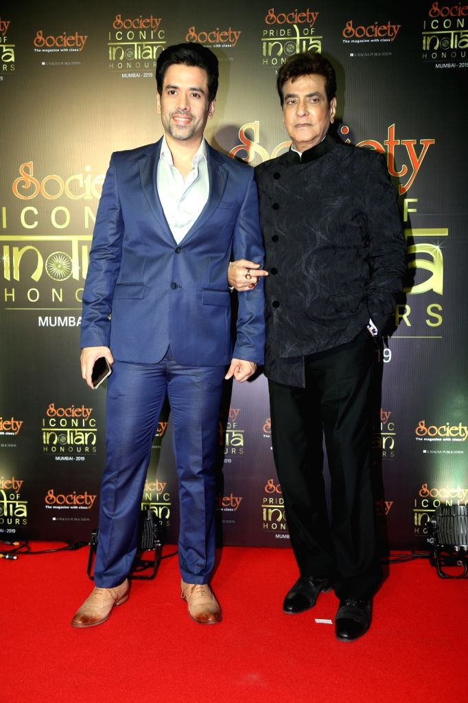 Actor Jeetendra with his son actor Tusshar Kapoor during Society Awards at Taj Santacruz in Mumbai on Nov 16, 2019. - Jeetendra and Tusshar Kapoor