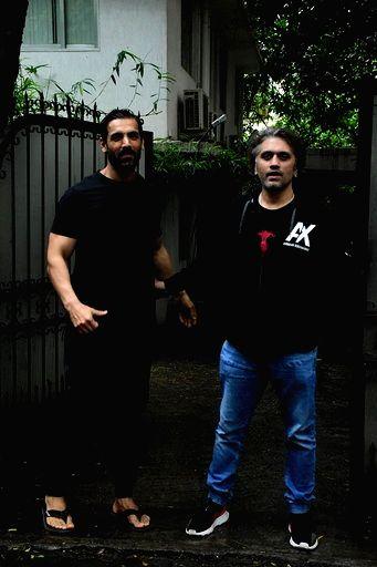 Actor John Abraham and filmmaker Mohit Suri seen at Bandra in Mumbai on Sep 22, 2020. - John Abraham