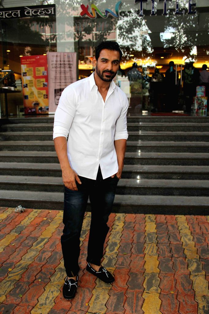 Actor John Abraham during the book launch of 4th Dimension written by Architect Chandrakant Patel, in Mumbai on Aug 23, 2015. - John Abraham and Chandrakant Patel