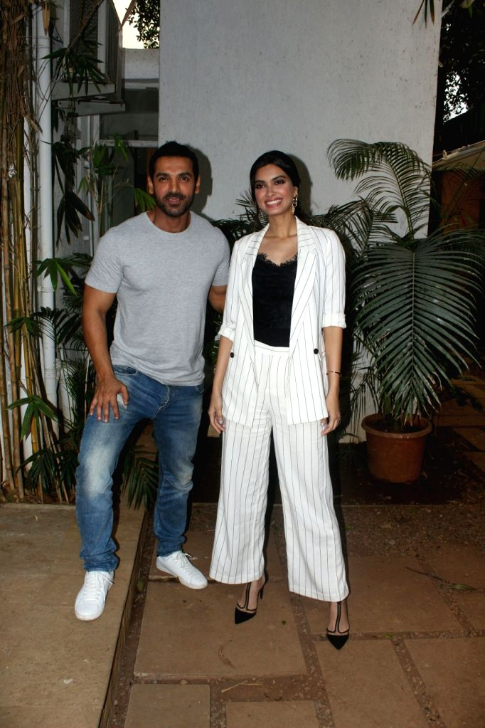 Actor John Abraham seen with actress Diana Penty at his office in Bandra, Mumbai on May 19, 2018. - John Abraham